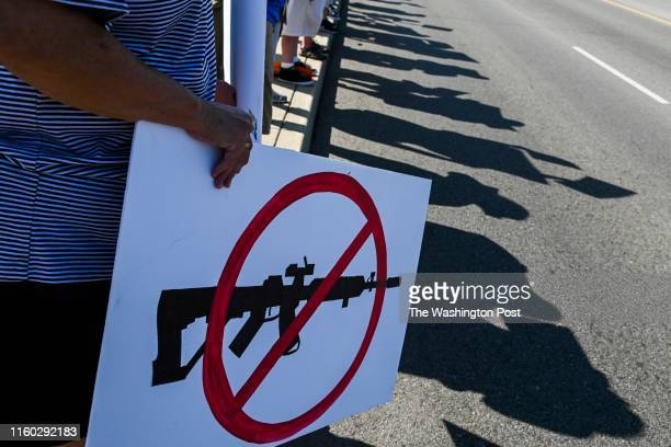 Demonstrators gather to protest the visit of Donald Trump to the city following the mass shooting by Connor Betts, on Wednesday, August 7 in Dayton,...