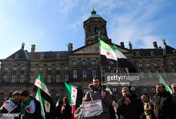 Demonstrators gather to stage a demonstration against Assad regime forces and Russia on the seventh year of Syrian civil war at Dam Square in...