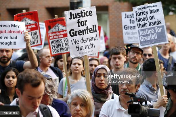 Demonstrators gather with placards outside the Department for Communities and Local Government in central London on June 16 2017 to demand justice...