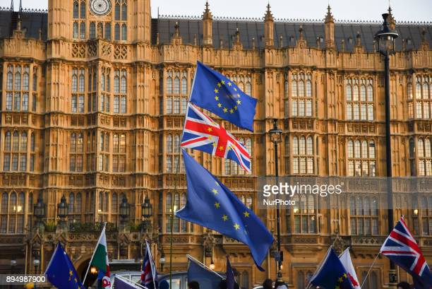 Demonstrators gathered to protest against Brexit outside the Parliament waving EU and Union flags s the sun sets London on December 18 2017 Theresa...