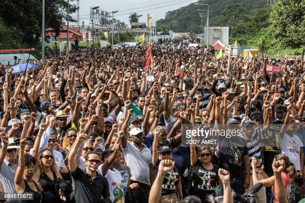 TOPSHOT Demonstrators gesture as they gather near Kourou space center on April 4 2017 in Kourou French Guiana during a protest over security and the...