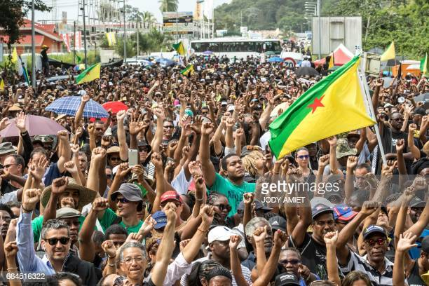 Demonstrators gesture as they gather near Kourou space center on April 4 2017 in Kourou French Guiana during a protest over security and the state of...