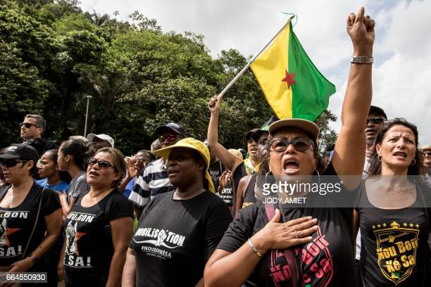Demonstrators gesture during a protest at Kourou space center on April 4 2017 in Kourou French Guiana to demand pay raises and improved public safety...