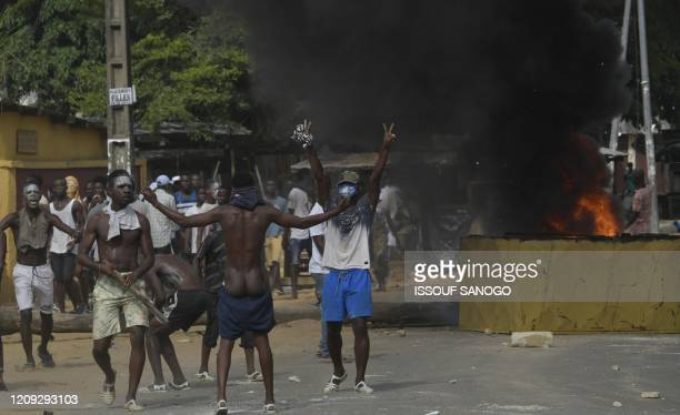 Demonstrators gesture during clashes against Ivory Coast anti-riot police at a demonstration against the construction of a COVID-19 coronavirus...