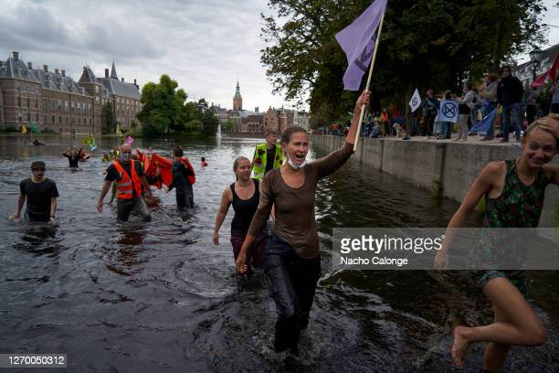 Demonstrators get into Lake Hofvijver next to the parliament in protest during the demonstration in The Hague on September 1 2020 in The Hague...