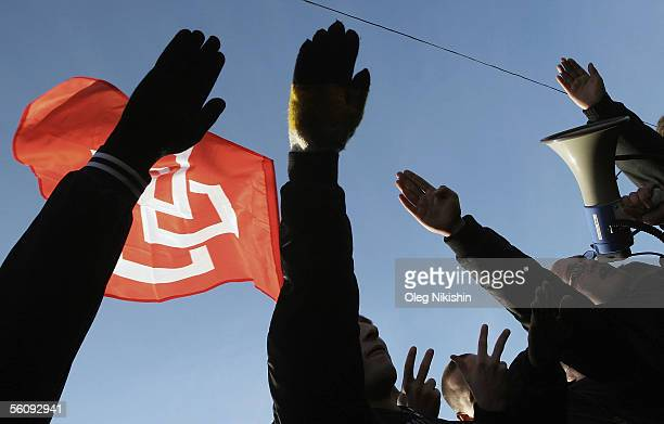 Demonstrators give the Nazi salute as they carry a styled swastika flag during a march called by several ultranationalist organizations marking the...