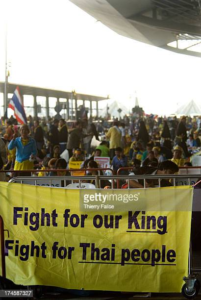 Demonstrators have put a banner reading Fight for our King fight for Thai people in front of the airport's departure hall Thousands of followers of...