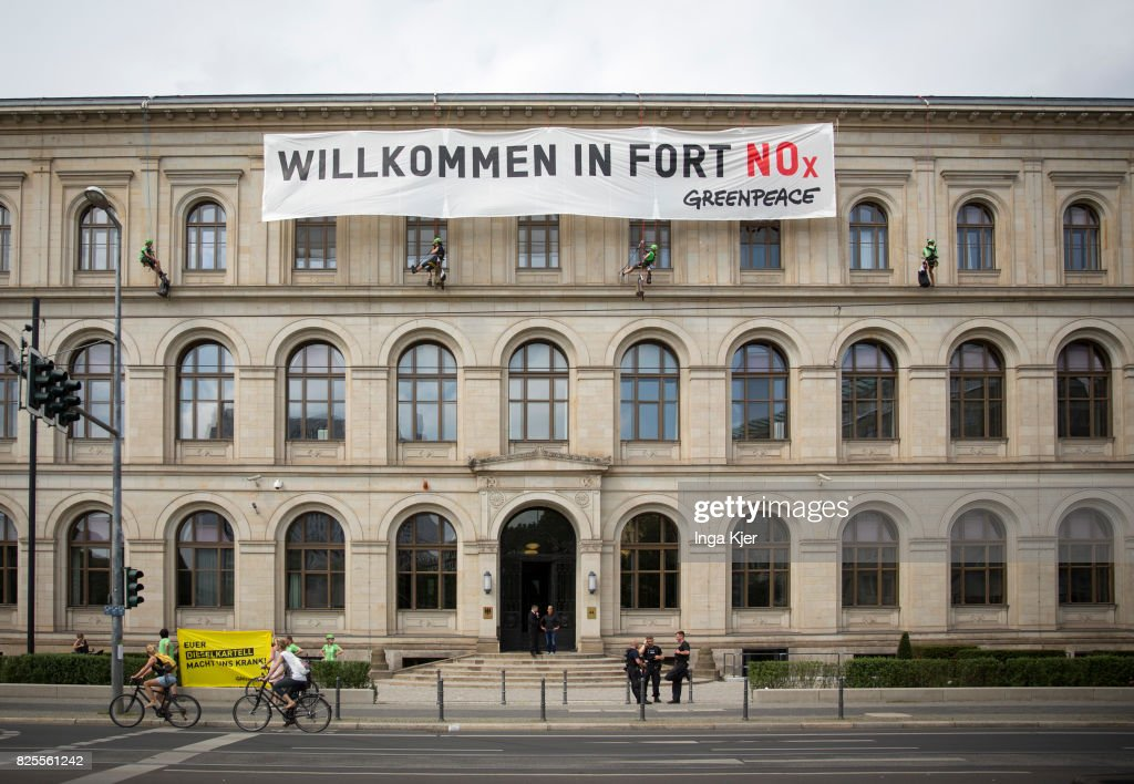 Demonstrators have put up a banner on to the Ministry of Transport right before a press conference in the course of the Diesel Summit on August 02, 2017 in Berlin, Germany. Representatives of the automobile industry and federal politics meet to find solutions in reducing the pollutant emissions of diesel vehicles.