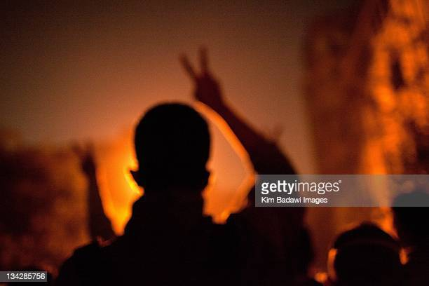 Demonstrators hide after street battles with Egyptian security forces on in smaller alleyways off Mohamed Mahmoud in downtown Cairo on November 23...