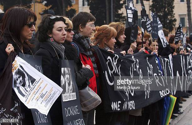 Demonstrators hold a banner and pictures of the Italian journalist Giuliana Sgrena during a demonstration on February 19 2005 in Rome Italy Thousands...