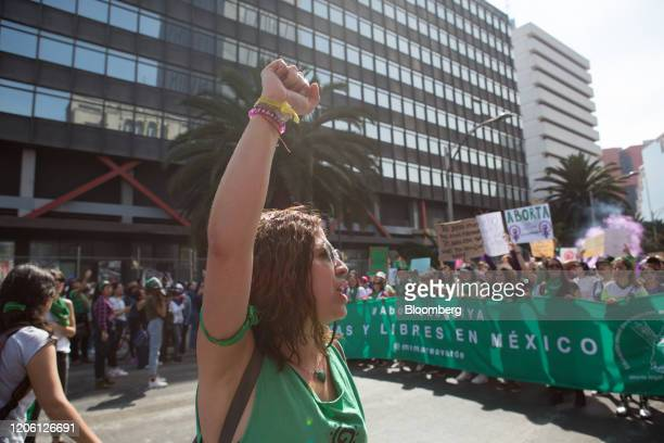 Demonstrators hold a banner and shout slogans during a rally on International Women's Day in Mexico City Mexico on Friday March 8 2020 The United...