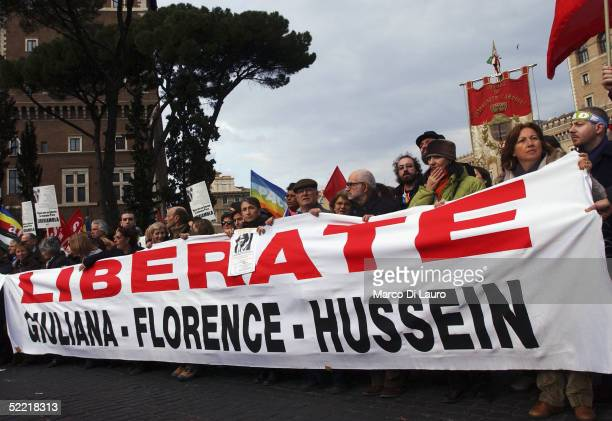 Demonstrators hold a banner asking for the release of the Italian journalist Giuliana Sgrena French journalist Florence Aubenas and her driver...