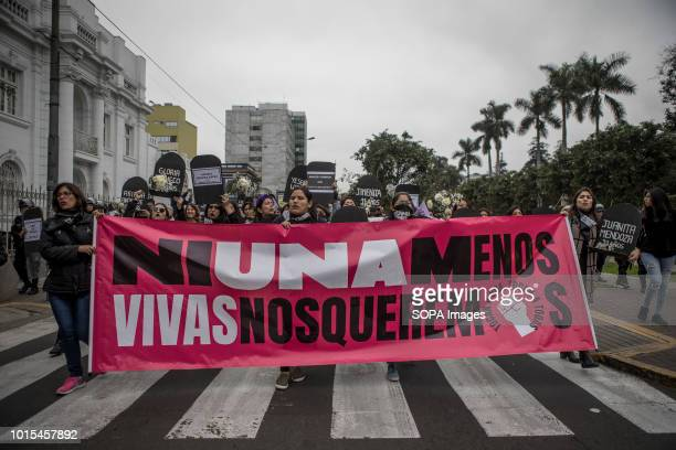 Demonstrators hold a banner during a Ni Una Menos rally in protest against gender based violence in Lima Ni Una Menos demands that women should be...