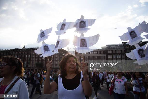 Demonstrators hold a banner during a protest to commemorate the massacre of the Plaza de las Tres Culturas of 1968 at the Zocalo on October 2 2019 in...