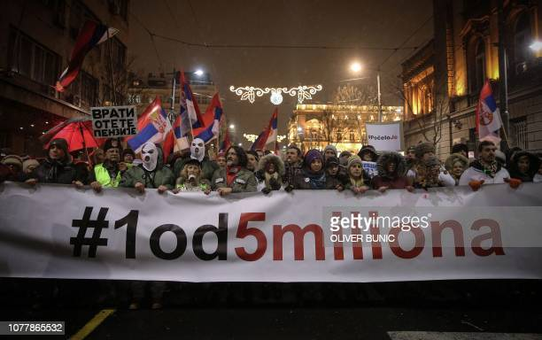 Demonstrators hold a banner reading 1 out of 5 million as they protest against the Serbian government in Belgrade on January 5 2019 Thousands of...