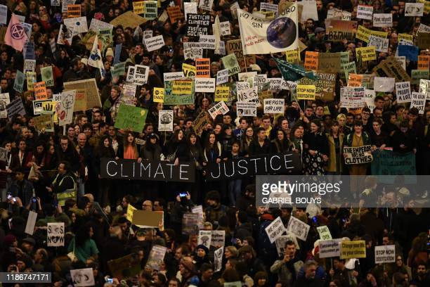 Demonstrators hold a banner reading Climate Justice during a mass climate march to demand urgent action on the climate crisis from world leaders...