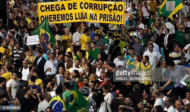 Demonstrators hold a banner reading 'Enough of corruption We want Lula in prison' referring to Brazilian former President Luiz Inacio Lula Da Silva...