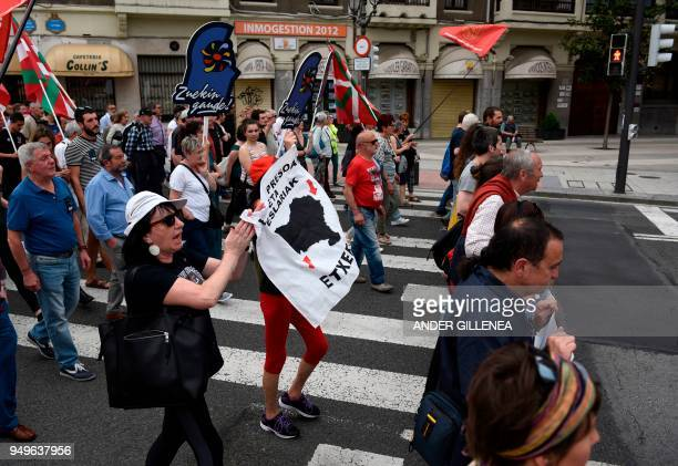 Demonstrators hold a banner reading in Basque 'Basque prisonners come home' during a demonstration called by the Kalera Kalera Initiative calling for...