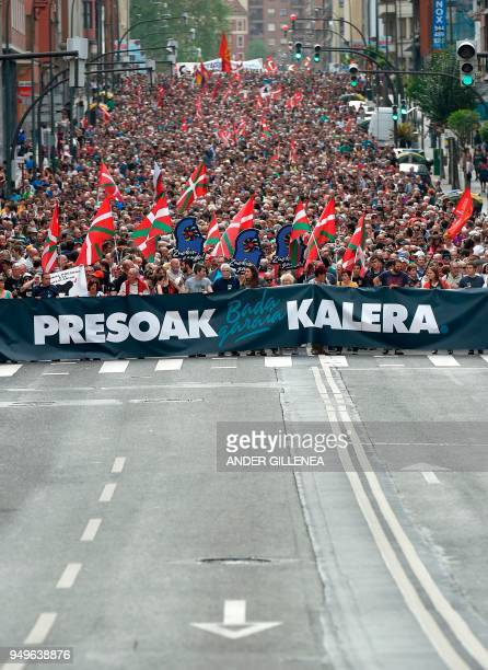 Demonstrators hold a banner reading in Basque 'It's time Basque prisonners come back home' during a demonstration called by the Kalera Kalera...