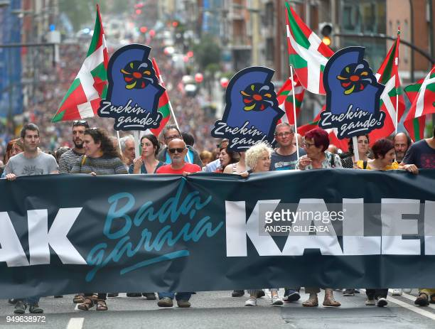 Demonstrators hold a banner reading in Basque 'It's time Basque prisoners come back home' during a demonstration called by the Kalera Kalera...