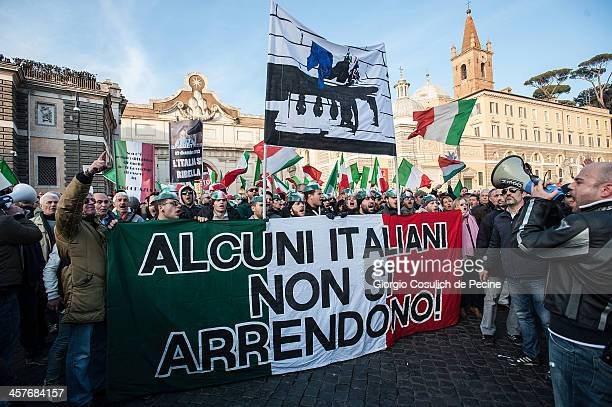 Demonstrators hold a banner reading 'some Italians do not give up' as they take part in the protest of the Forconi Movement at Piazza del Popolo on...