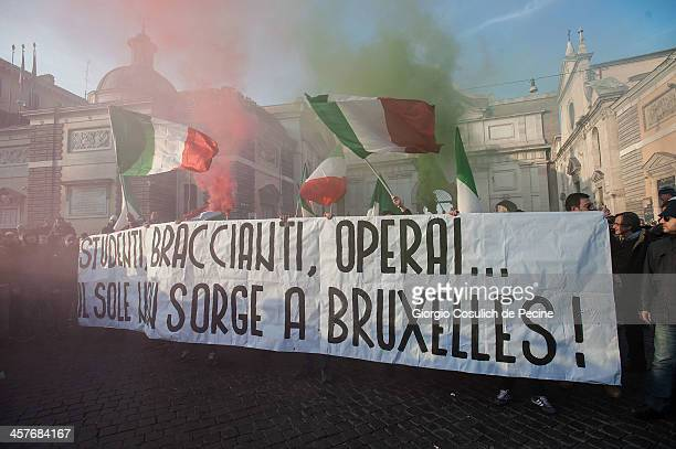 Demonstrators hold a banner reading 'Students, laborers, workers, the sun does not rise in Brussels' as they take part in the protest of the Forconi...
