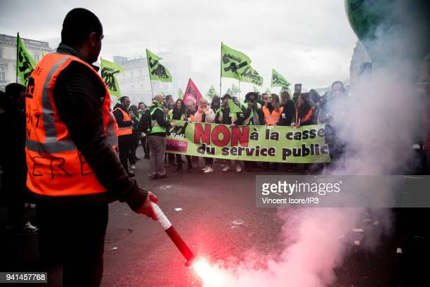 Demonstrators hold a banner with the message no to public service scrap during the demonstration against the breakup of the public railway service on...