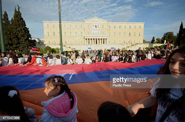 Demonstrators hold a giant Armenian flag passing in front of the Greek parliament Armenians that live in Greece organised a demonstration to remember...