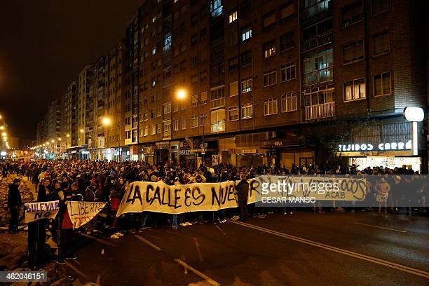 Demonstrators hold a placard during a protest against imminent construction works to revamp Vitoria street the city's main thoroughfare in Burgos on...