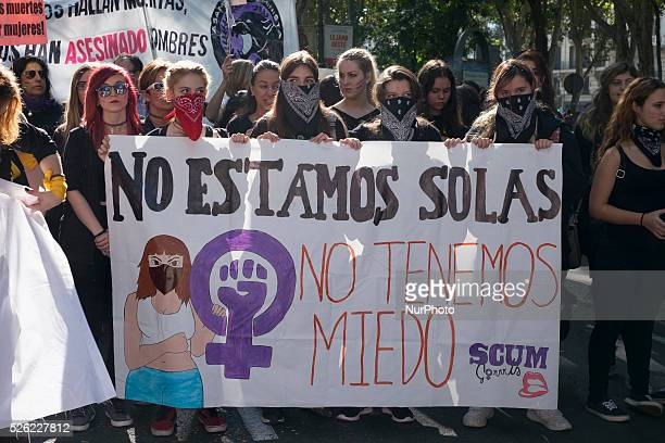 Demonstrators hold a placards against gender violence during a demonstration against domestic violence in Madrid on November 7 2015 Forty one women...