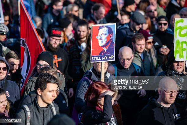 "Demonstrators hold a poster showing former Thuringian state premier Bodo Ramelow and reading ""Still my MP"" as they rally for a protest themed ""Not..."