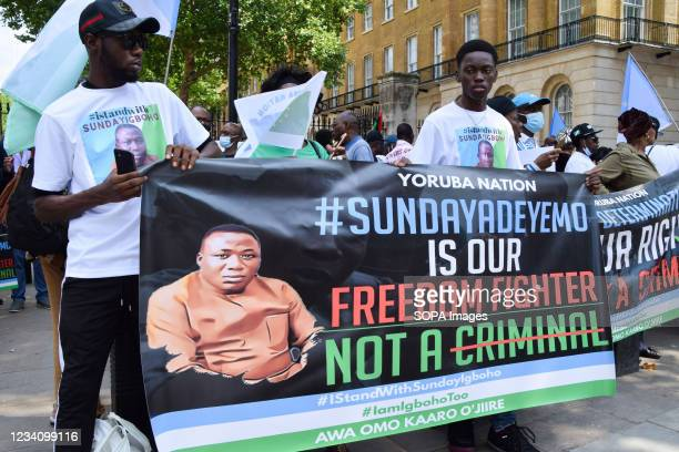 Demonstrators hold a pro-Sunday Igboho banner during the Yoruba Nation protest. Nigeria's Yoruba Nation supporters gathered outside Downing Street to...