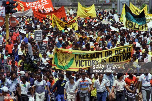 Demonstrators hold a protest march through downtown Johannesburg 14 October 1989 to support the imminent release of African National Congress...
