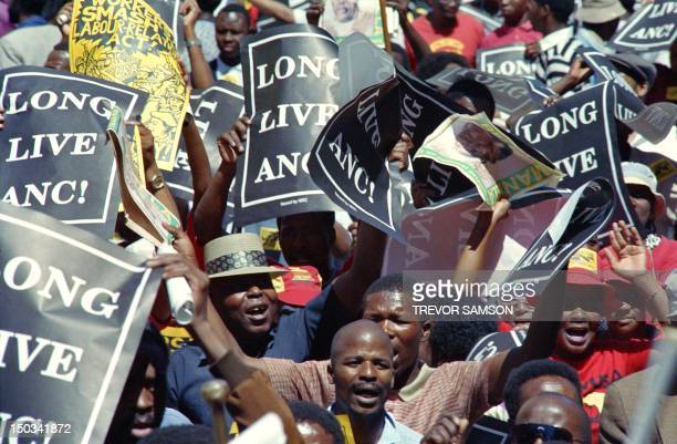 Demonstrators hold a protest march through downtown Johannesburg on October 14 1989 against the labour relations act and to support the imminent...