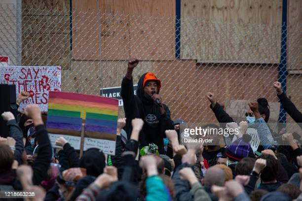 Demonstrators hold a rally and teach-in outside of the Seattle Police Departments East Precinct, which has been boarded up and protected by fencing,...