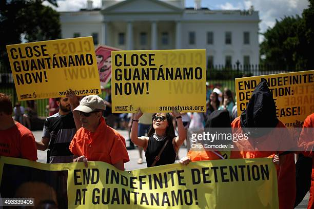 Demonstrators hold a rally to urge President Barack Obama to fulfill his pledge to close the military prison at Guantanamo Bay Cuba and end...