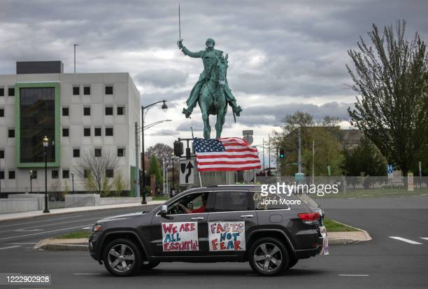 Demonstrators hold a Rolling Car Rally against Democratic Governor Ned Lamont's stayathome order to combat the coronavirus pandemic on May 04 2020 in...