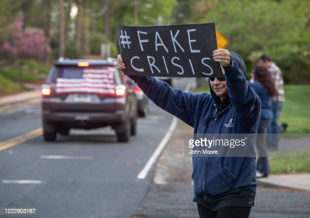 """Demonstrators hold a """"Rolling Car Rally"""" in front of Democratic Governor Ned Lamont's residence while protesting the state's stay-at-home order to..."""