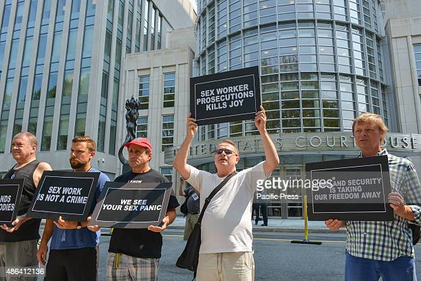 Demonstrators hold a series of printed signs while standing in front of the US Eastern District Courthouse Activists from New York City's LGBTQ...