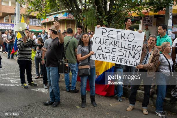 Demonstrators hold a sign during protest near a campaign rally for Gustavo Petro presidential candidate for the Progressivists Movement Party not...