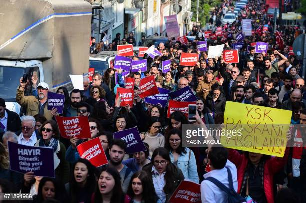 Demonstrators hold a sign reading 'No The referendum should be cancelled' during a protest at the Kadikoy district in Istanbul on April 23 2017...