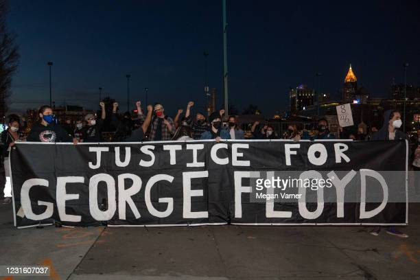 Demonstrators hold a vigil in honor of George Floyd on March 8, 2021 in Atlanta, Georgia. Jury selection was paused today in the trial of former...