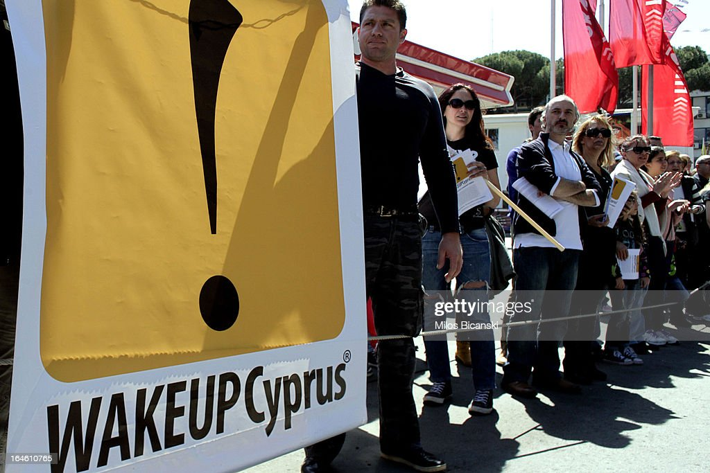 Demonstrators hold an anti-bailout banner during a student parade marking Greece's Independence Day on March 25, 2013 in Nicosia, Cyprus. After days of negotiation, Eurozone finance ministers have agreed terms for a 10 billion euro bailout deal, which aims to prevent the collapse of Cypriot banks and ensure that Cyprus remain in the Eurozone.