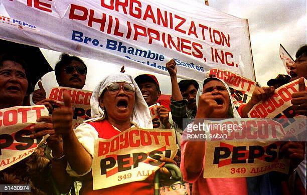 Demonstrators hold an antiPepsi rally outside of the House of Representatives in suburan Manila 02 August 1993 The protestors who were victims of an...