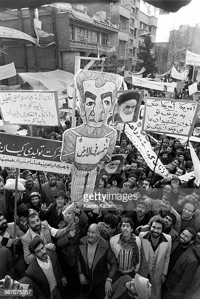 Demonstrators hold an effigy of the Shah of Iran and posters of Ayatollah Khomeini outside the American Embassy which is occupied by 'students...