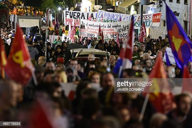 Demonstrators hold banners and flags during a protest dubbed ' Marches for Dignity' and under the slogan 'Bread Work Roof and Dignity' against...