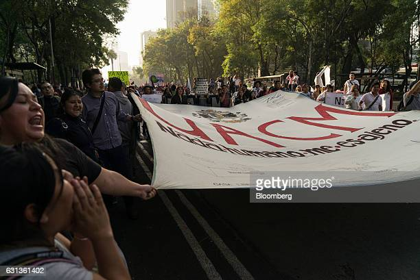 Demonstrators hold banners and march during a protest against the gasoline price hike in Mexico City Mexico on Monday Jan 9 2017 The government is...