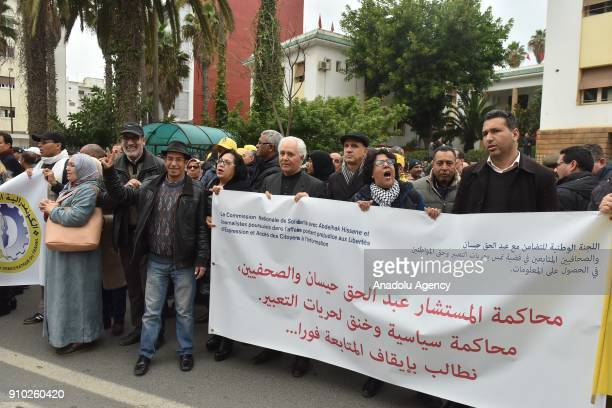 Demonstrators hold banners and shout slogans as they gather outside the Court of General Sessions to stage a protest against the trial of four...