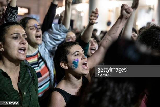 Demonstrators hold banners and shout slogans during the International Day for the Elimination of Violence against Women rally at Beyoglu district of...