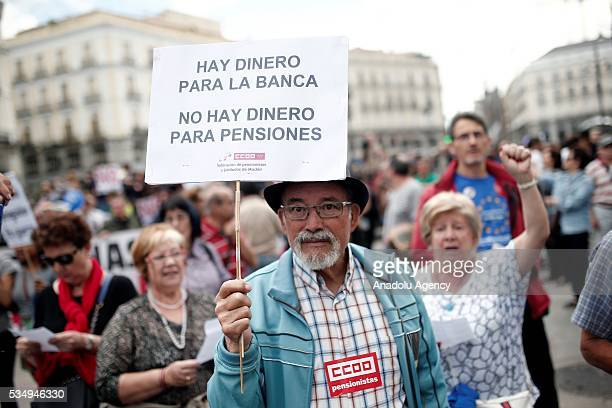 Demonstrators hold banners as they protest against the Government's austerity measures applied due to the Spanish economic crisis that began in 2008...